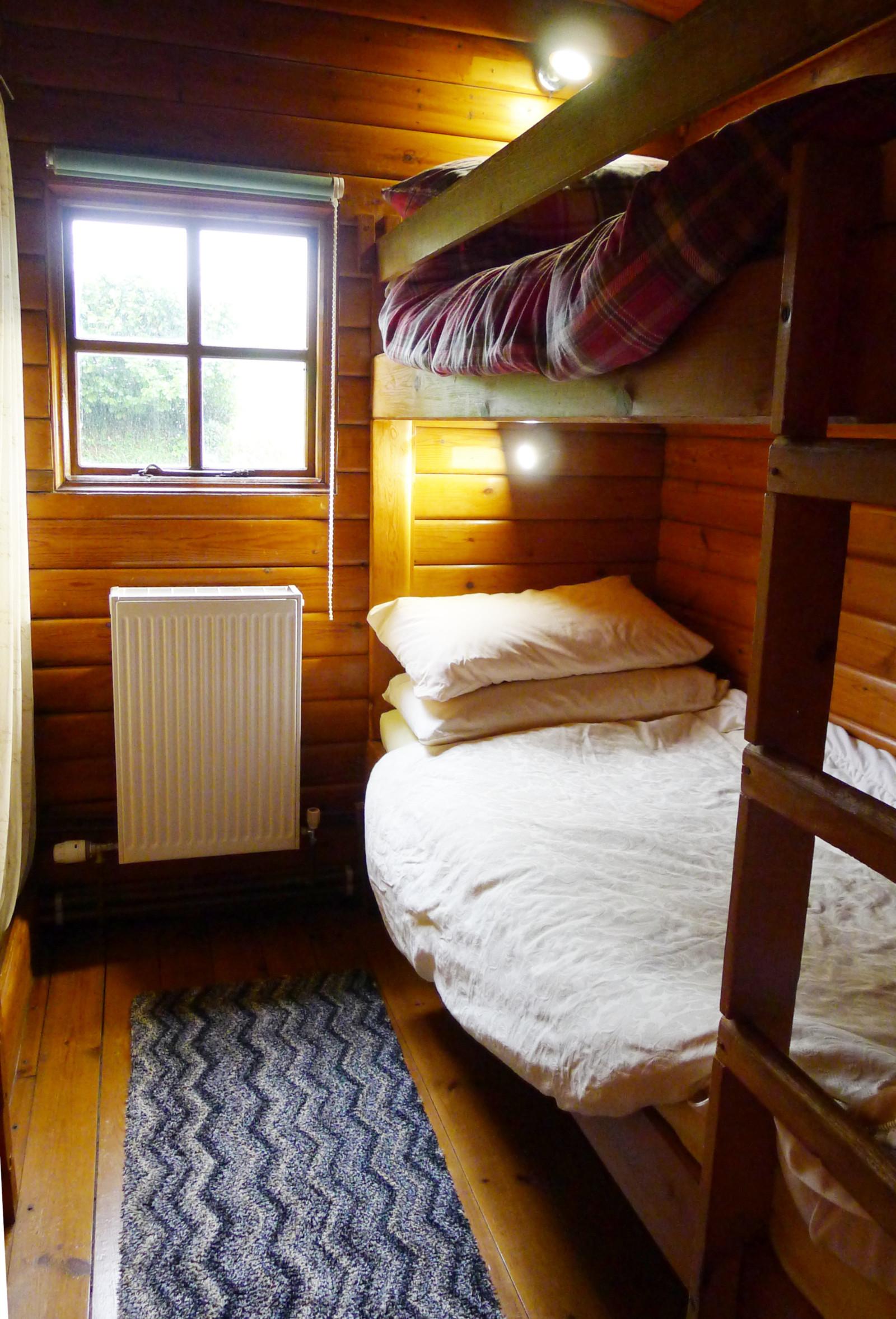 Morlogws Farm Holidays - The Log Cabin Bedroom